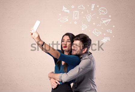 Stock photo: Couple taking selfie with thoughts illustrated