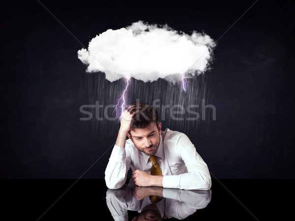 Depressed businessman sitting under a cloud Stock photo © ra2studio