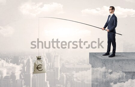 Businessman on rock mountain with a dollar mark Stock photo © ra2studio