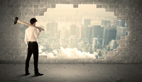 деловой человек стены молота город бизнесмен Сток-фото © ra2studio