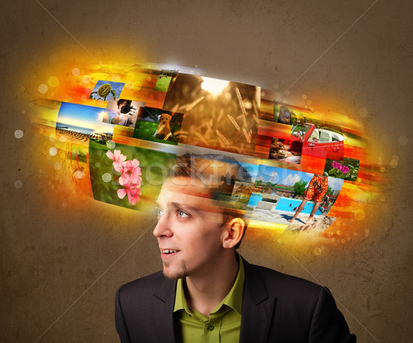 man with colorful glowing photo memories concept Stock photo © ra2studio