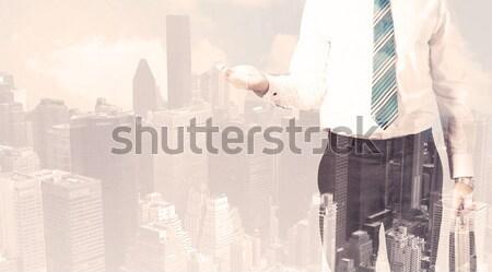 Bonito homem de negócios cityscape edifício homem cidade Foto stock © ra2studio