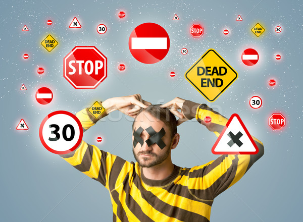 Young man with glued eye and traffic signals Stock photo © ra2studio