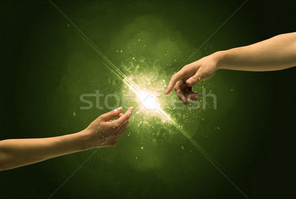 Dokunmak silah aydınlatma kıvılcım parmak ucu iki Stok fotoğraf © ra2studio