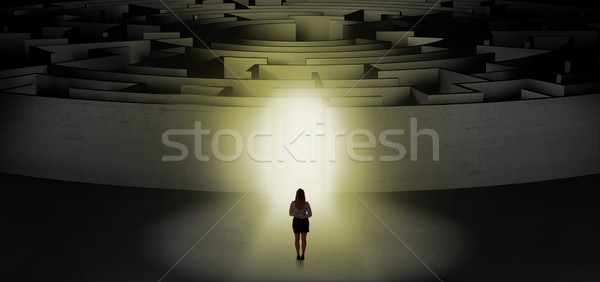 Woman starting a concentric labyrinth Stock photo © ra2studio