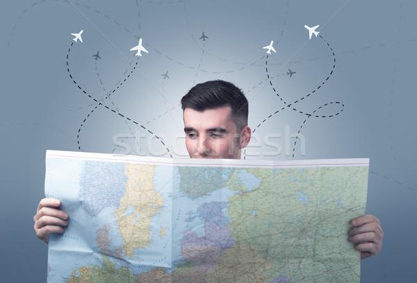 Junger Mann halten Karte gut aussehend wenig Flugzeuge Stock foto © ra2studio