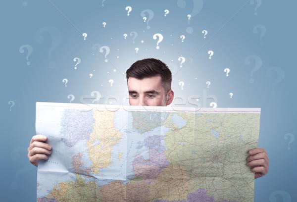 Junger Mann halten Karte gut aussehend weiß Fragezeichen Stock foto © ra2studio