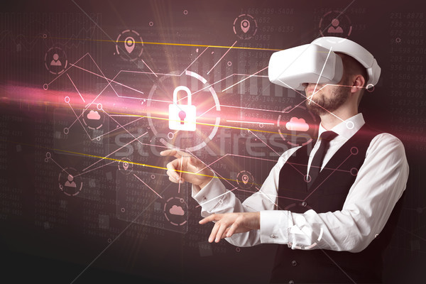 Man with VR goggles unlocking 3D network concept Stock photo © ra2studio