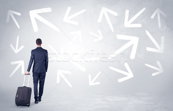 Stock photo: Businessman leaving with pell-mell arrows around