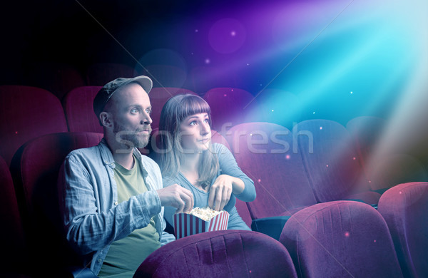 Teenager couple watching movie  Stock photo © ra2studio
