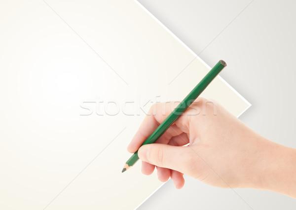 Mano humana dibujo lápiz vacío papel plantilla Foto stock © ra2studio