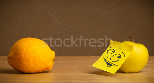 Apple with post-it note looking curiously at lemon Stock photo © ra2studio