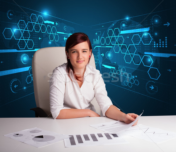 Businesswoman doing paperwork with futuristic background Stock photo © ra2studio