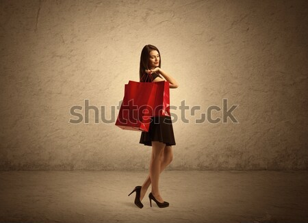 Shopping girl with bags and clear background Stock photo © ra2studio