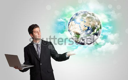 Young man with earth and cloud concept Stock photo © ra2studio