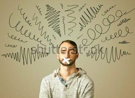 Young man with glued eye and curly lines Stock photo © ra2studio