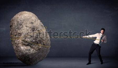 Empresário enorme rocha corda negócio Foto stock © ra2studio