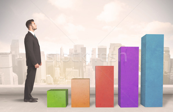 Business person climbing up on colourful chart pillars concept Stock photo © ra2studio