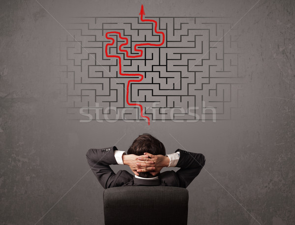 Stock photo: Business man looking at a maze and the way out