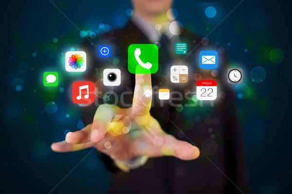 Guapo empresario colorido móviles aplicación Foto stock © ra2studio