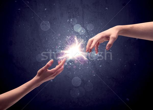 Mani luce scintilla due maschio altro Foto d'archivio © ra2studio