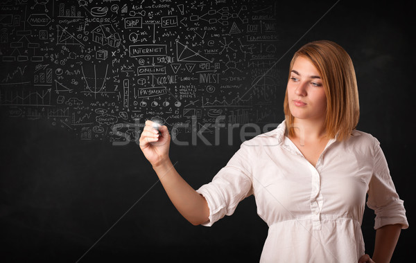 Stock photo: Young woman sketching and calculating thoughts