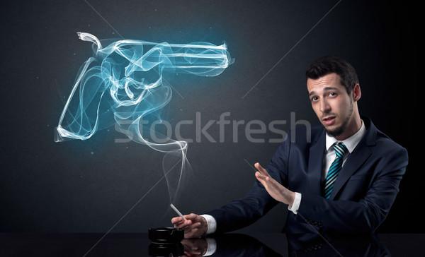 Businessman smoking concept Stock photo © ra2studio