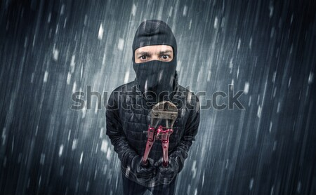 Armed villain in an empty dark room Stock photo © ra2studio