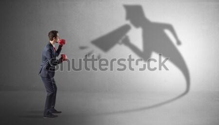 Zakenman schaduw permanente Rood doek Stockfoto © ra2studio