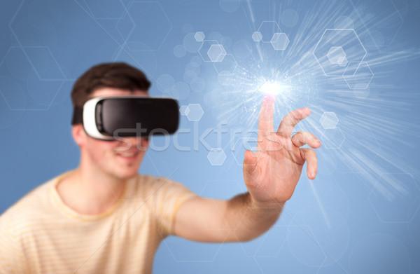 Férfi visel virtuális valóság védőszemüveg fiatal Stock fotó © ra2studio