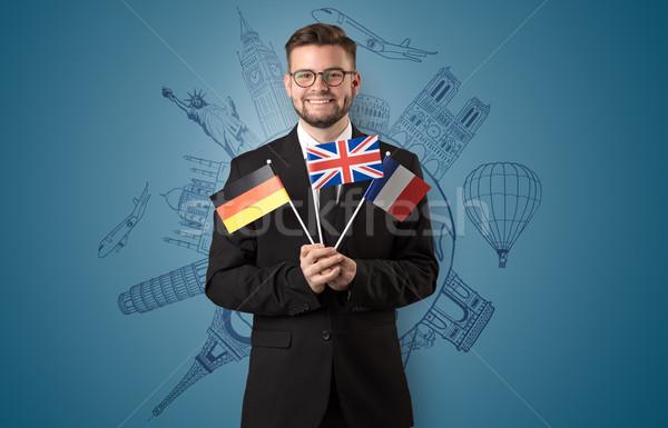 Elegancki człowiek zwiedzanie banderą strony budynku Zdjęcia stock © ra2studio