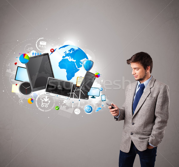 young boy standing and browsing on his phone Stock photo © ra2studio