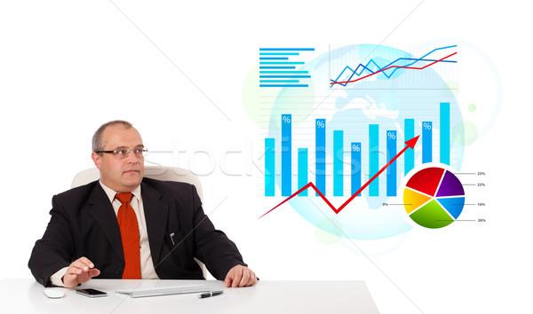 бизнесмен сидят столе статистика изолированный белый Сток-фото © ra2studio