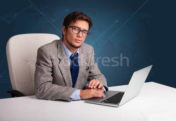 Moço sessão secretária datilografia laptop atraente Foto stock © ra2studio