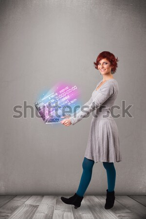 Casual woman holding laptop with exploding data and numers Stock photo © ra2studio