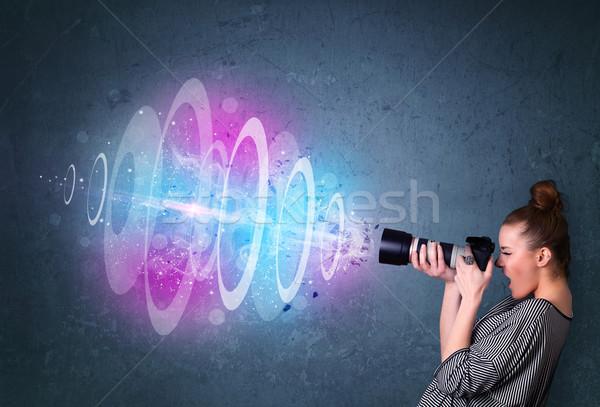 Stock photo: Photographer girl making photos with powerful light beam