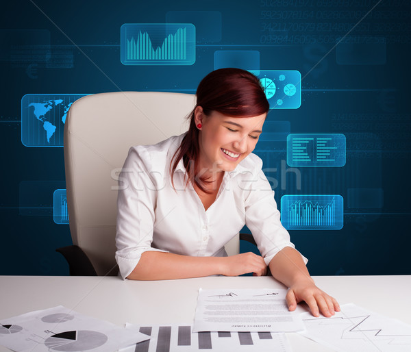 Businesswoman doing paperwork with digital background Stock photo © ra2studio