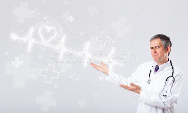Médico batida de coração abstrato coração homem médico Foto stock © ra2studio