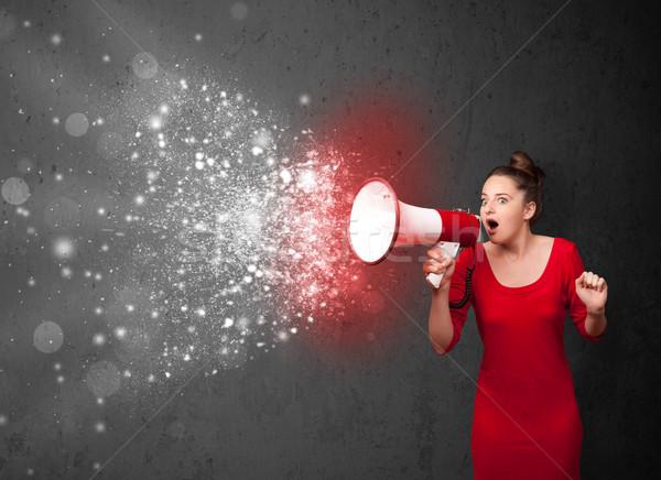 Kobieta megafon energii cząstki Zdjęcia stock © ra2studio