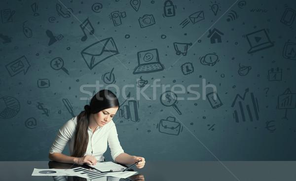 businesswoman with media icons background Stock photo © ra2studio