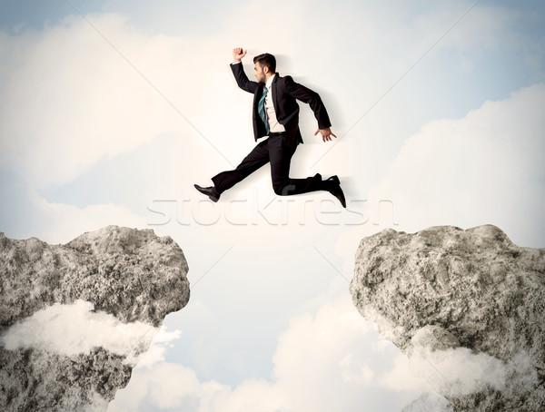 Mutlu iş adamı atlama uçurum iş adam Stok fotoğraf © ra2studio