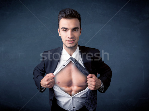Businessman tearing off shirt and showing mucular body Stock photo © ra2studio