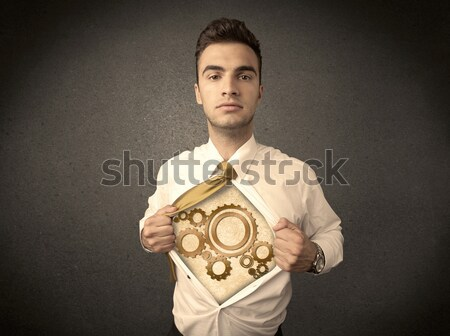 Businessman tearing shirt off and machine cog wheel shows Stock photo © ra2studio