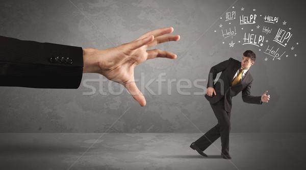 üzletember fut messze nagy kéz kérdez Stock fotó © ra2studio