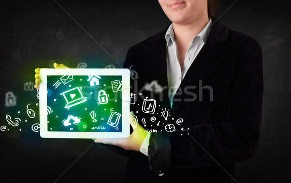 Person holding tablet with green media icons and symbols Stock photo © ra2studio