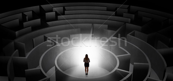 Woman choosing between entrances in a middle of a dark maze Stock photo © ra2studio