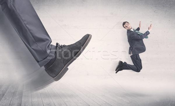 Grande pie fuego pequeño empresario negro Foto stock © ra2studio