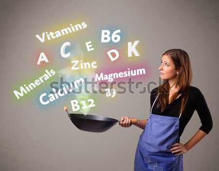 Genç kadın pişirme vitaminler mineraller güzel gıda Stok fotoğraf © ra2studio