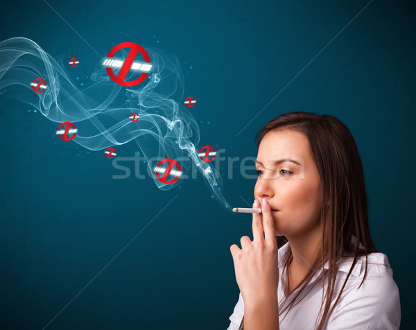 Young woman smoking dangerous cigarette with no smoking signs Stock photo © ra2studio