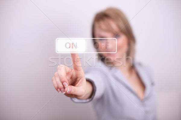 Woman pressing on/off button Stock photo © ra2studio